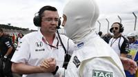 Eric Boullier a Jenson Button v Brazílii