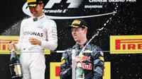 Nico Rosberg a Daniil Kvjat na pódiu po závodě v Číně
