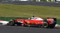 Kimi Räikkönen při pátečním tréninku v Malajsii