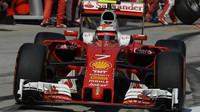 Kimi Räikkönen v závodě v Malajsii