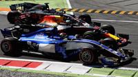 Romain Grosjean, Daniel Ricciardo a Pascal Wehrlein v závodě v Itálii