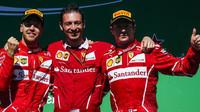 Sebastian Vettel a Kimi Räikkönen na pódiu po závodě v Brazílii