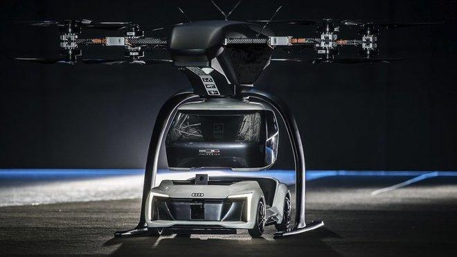 Zmenšený model konceptu létajícího autonomního taxi Audi Pop.Up Next se poprvé vznesl