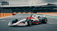 Koncept vozu Formule 1 pro sezónu 2022 na startovním roštu v Silverstone